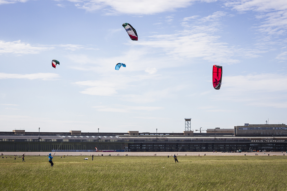 Berlinspiration: The Ultimate Guide to Our Students' Top 5 Berlin Areas | Tempelhof kiteboarders by Dominic Blewett